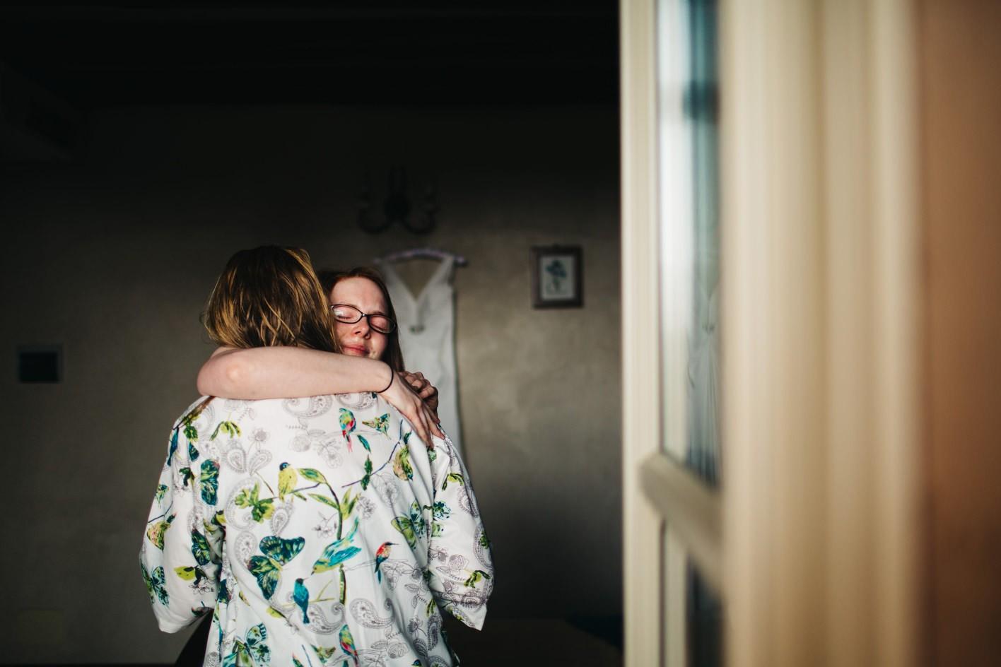 bride and bridesmaid hug