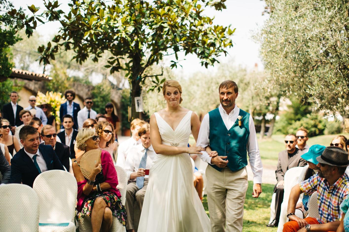 Bride walking down outdoor wedding ceremony