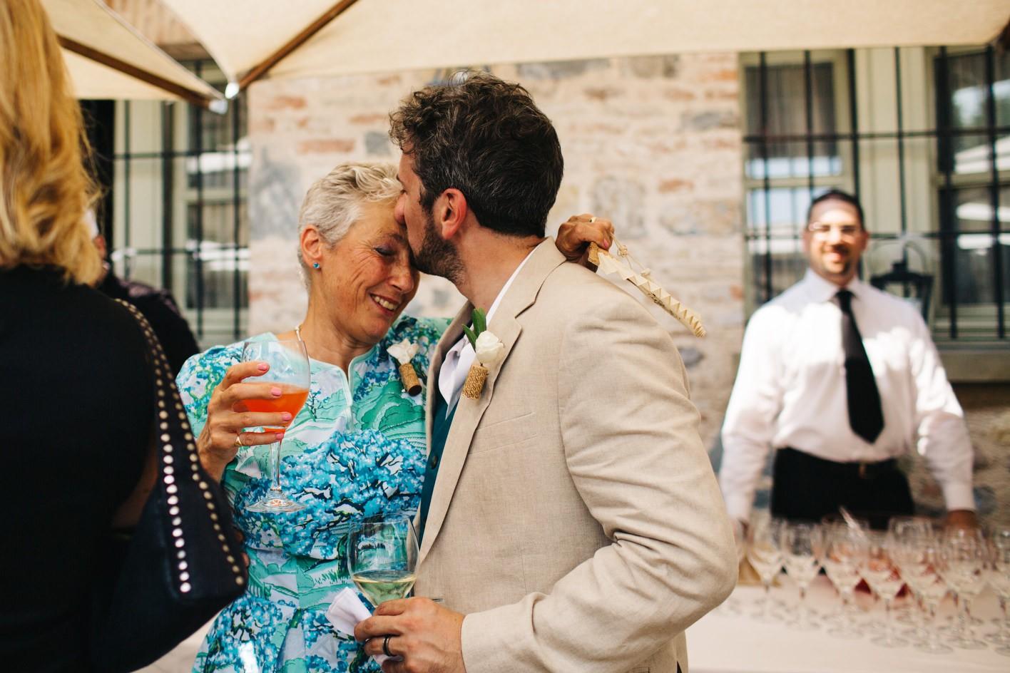 groom kisses mother