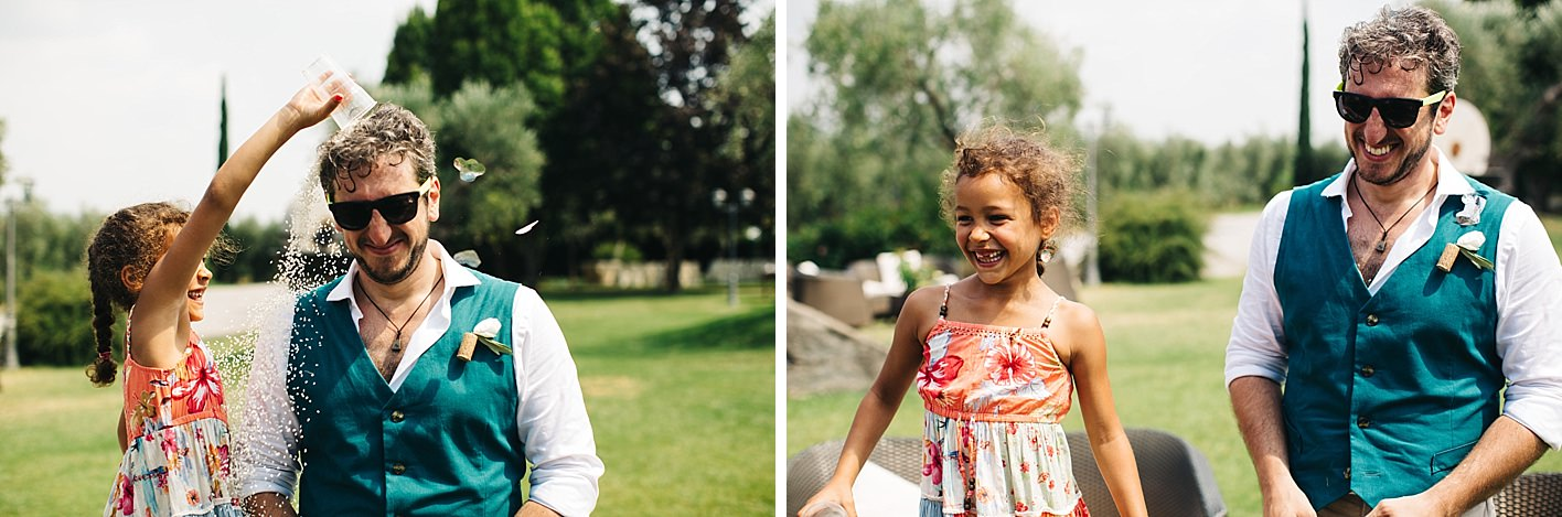 little girl pours confetti on Groom