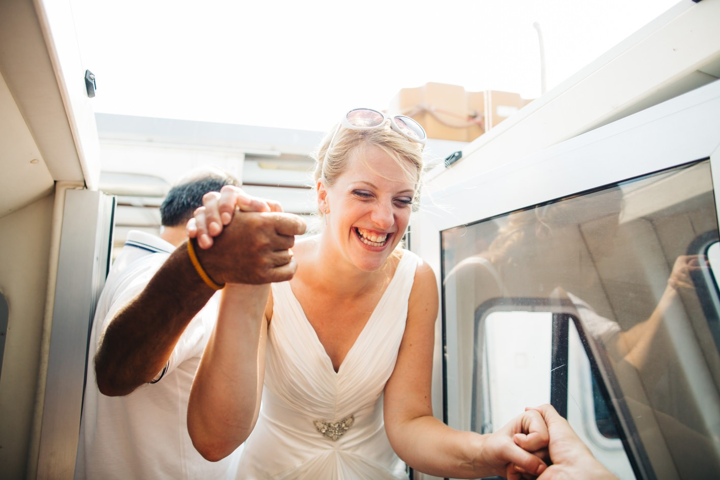 bride moves from one boat to another