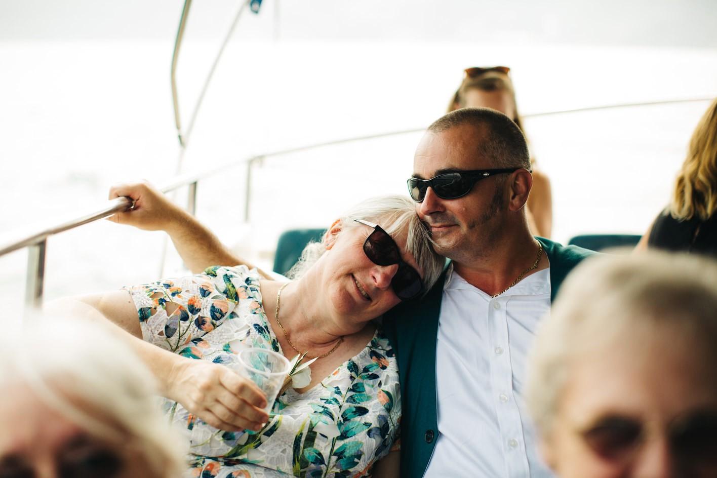 guests enjoy wedding boat trip around lake