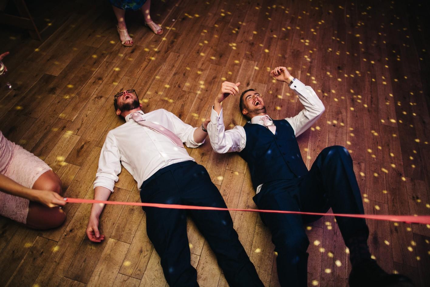 Limbo game on wedding dancefloor