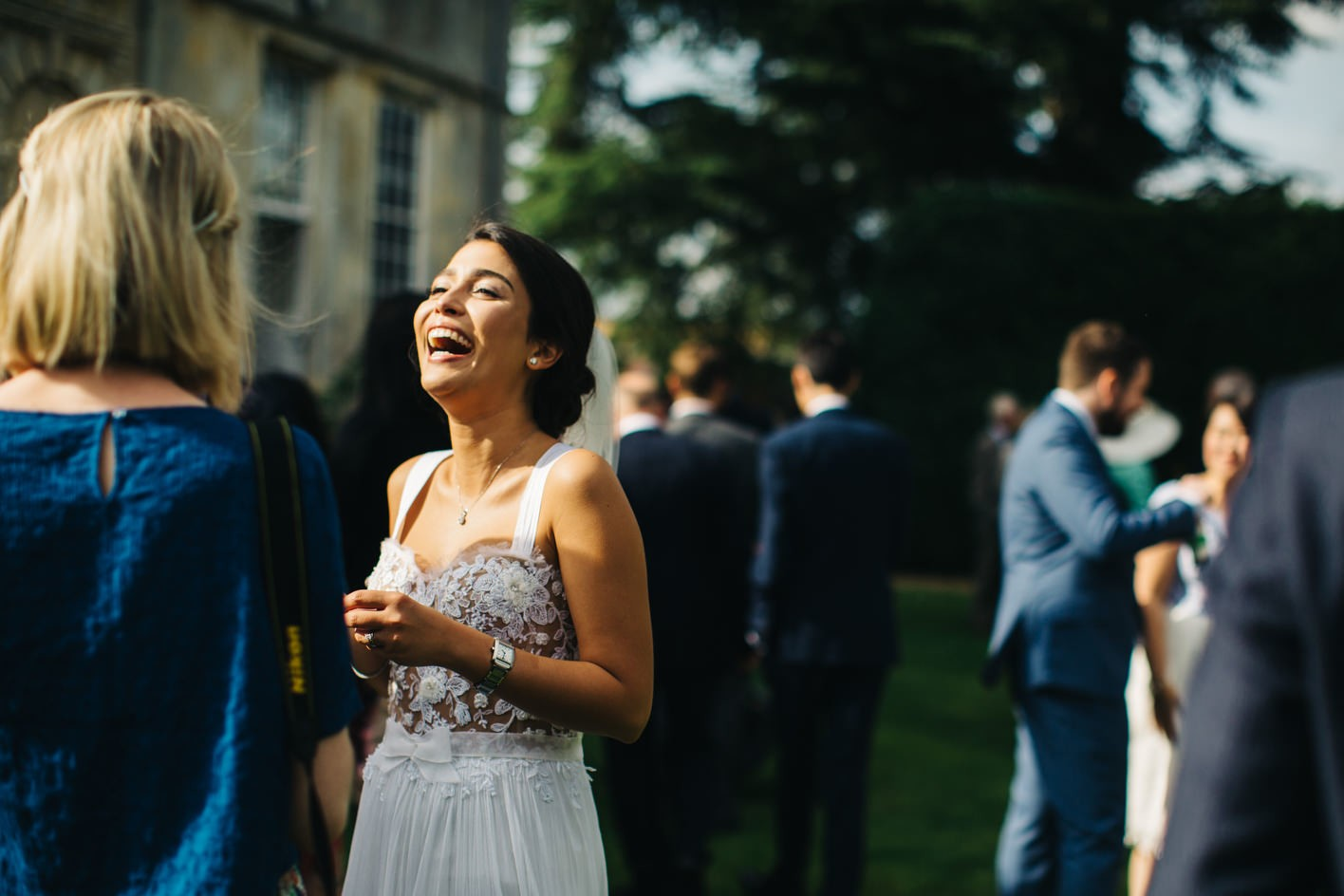 laughing bride during drinks reception