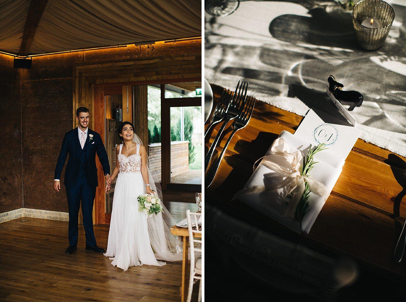 bride and groom look at reception room