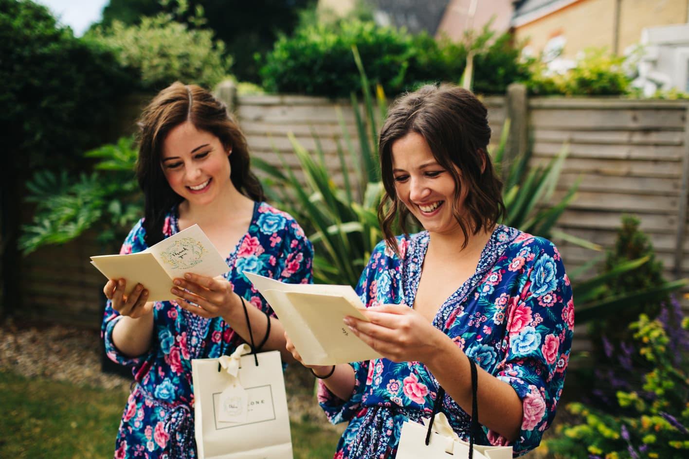 smiling bridesmaids opening gift
