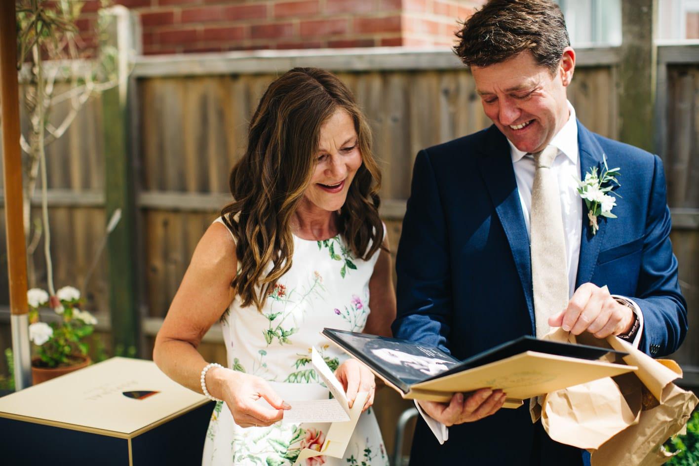 brides parents open gift