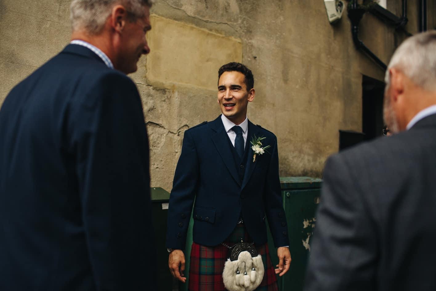 groom wearing a kilt