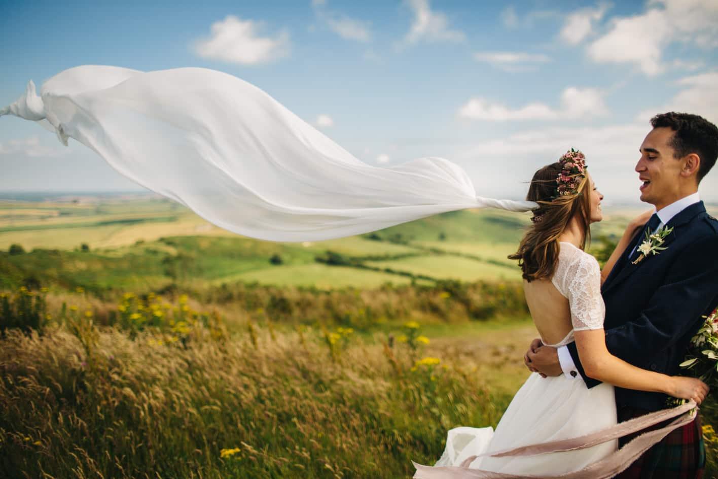 grace loves lace veil blowing in wind