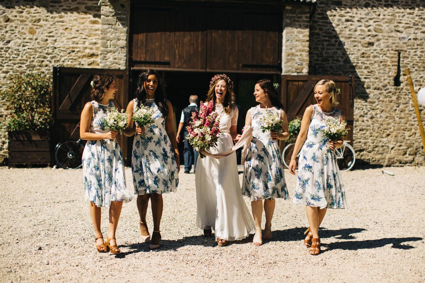 bride and bridesmaids lauging