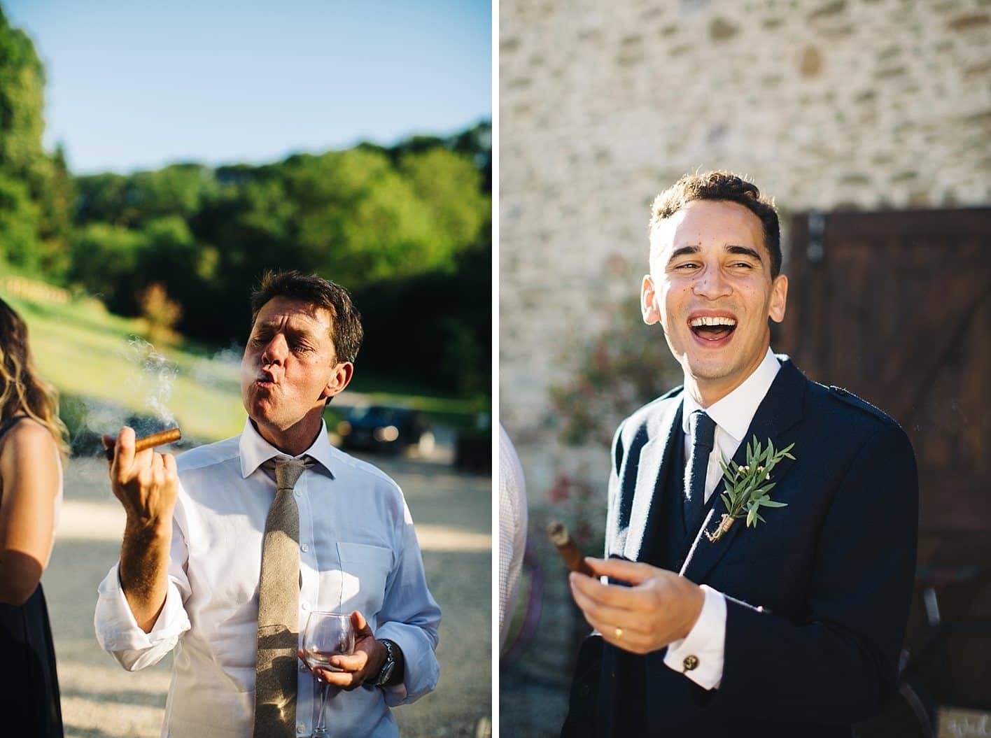 guys smoking cigars at wedding