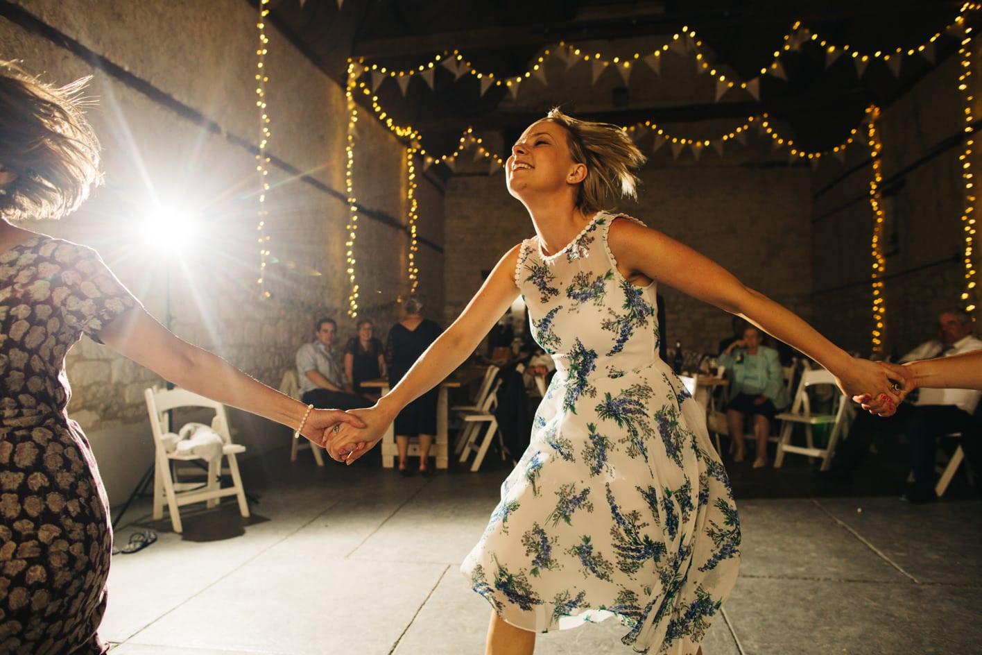 guest dancing at rustic wedding