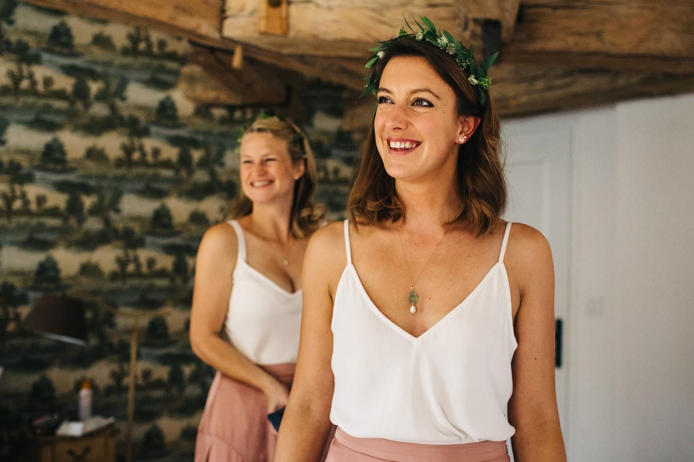 bridesmaids smile at bride