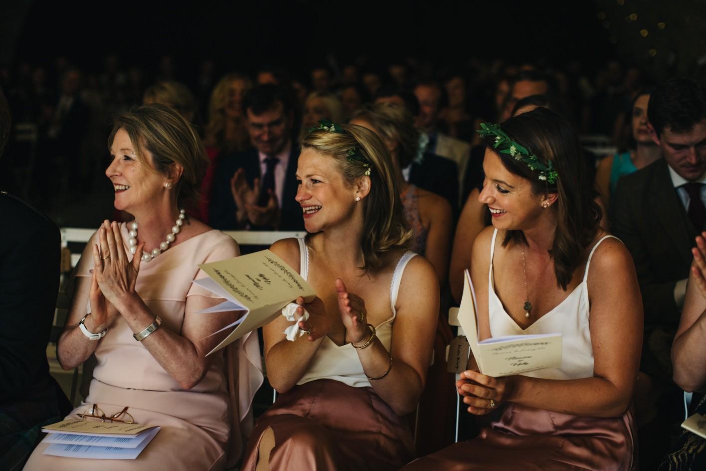 bridesmaid clap during wedding vows