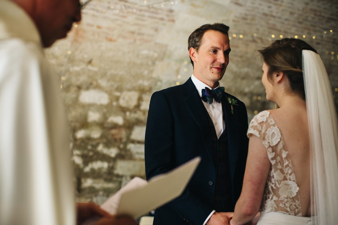 groom stares at bride