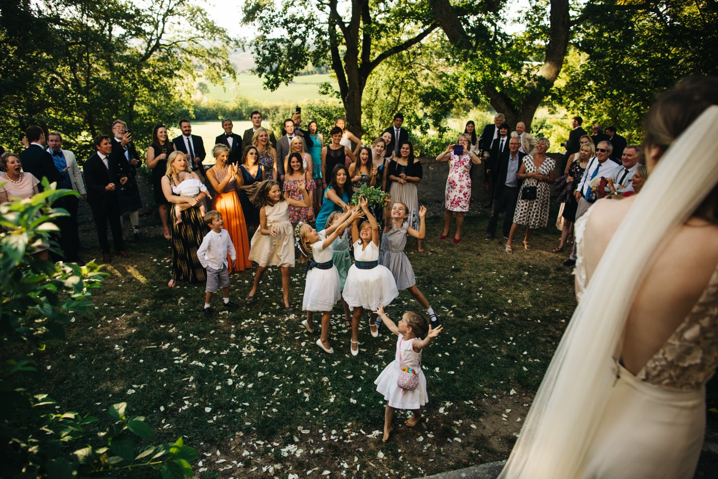 guests catch bouquet at chateau wedding near toulouse