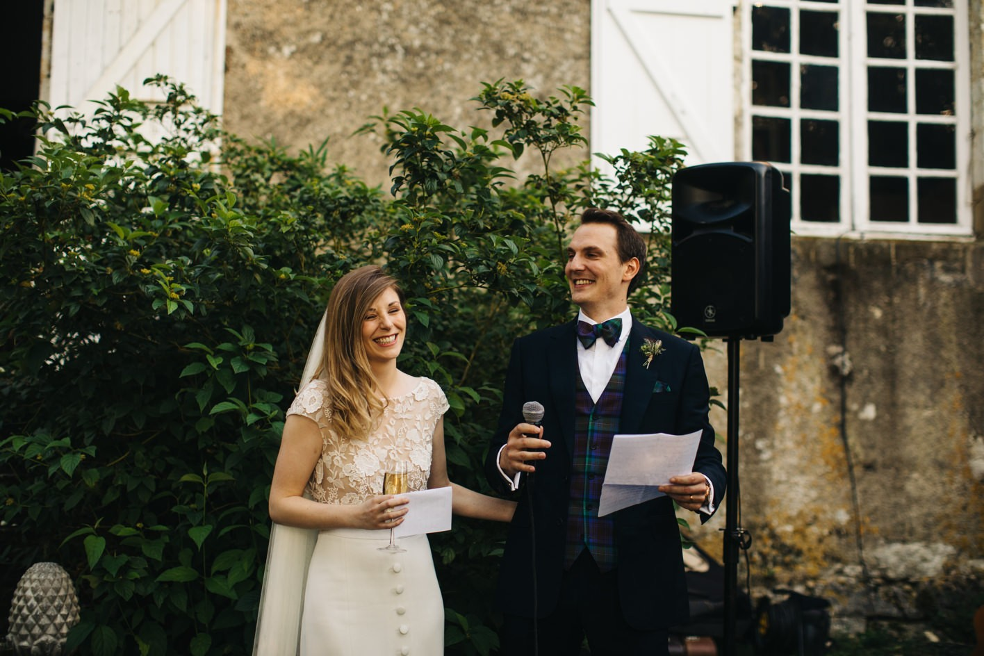 bride and groom make speech together