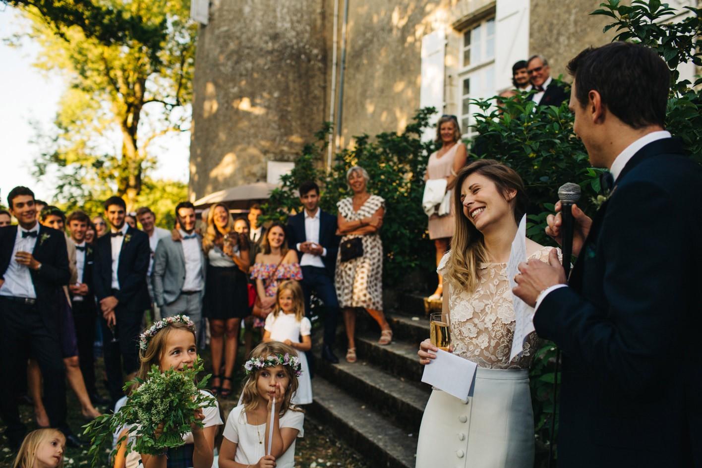 bride laughs during groom speech