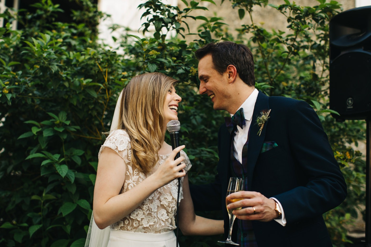 bride and groom laughing at french wedding