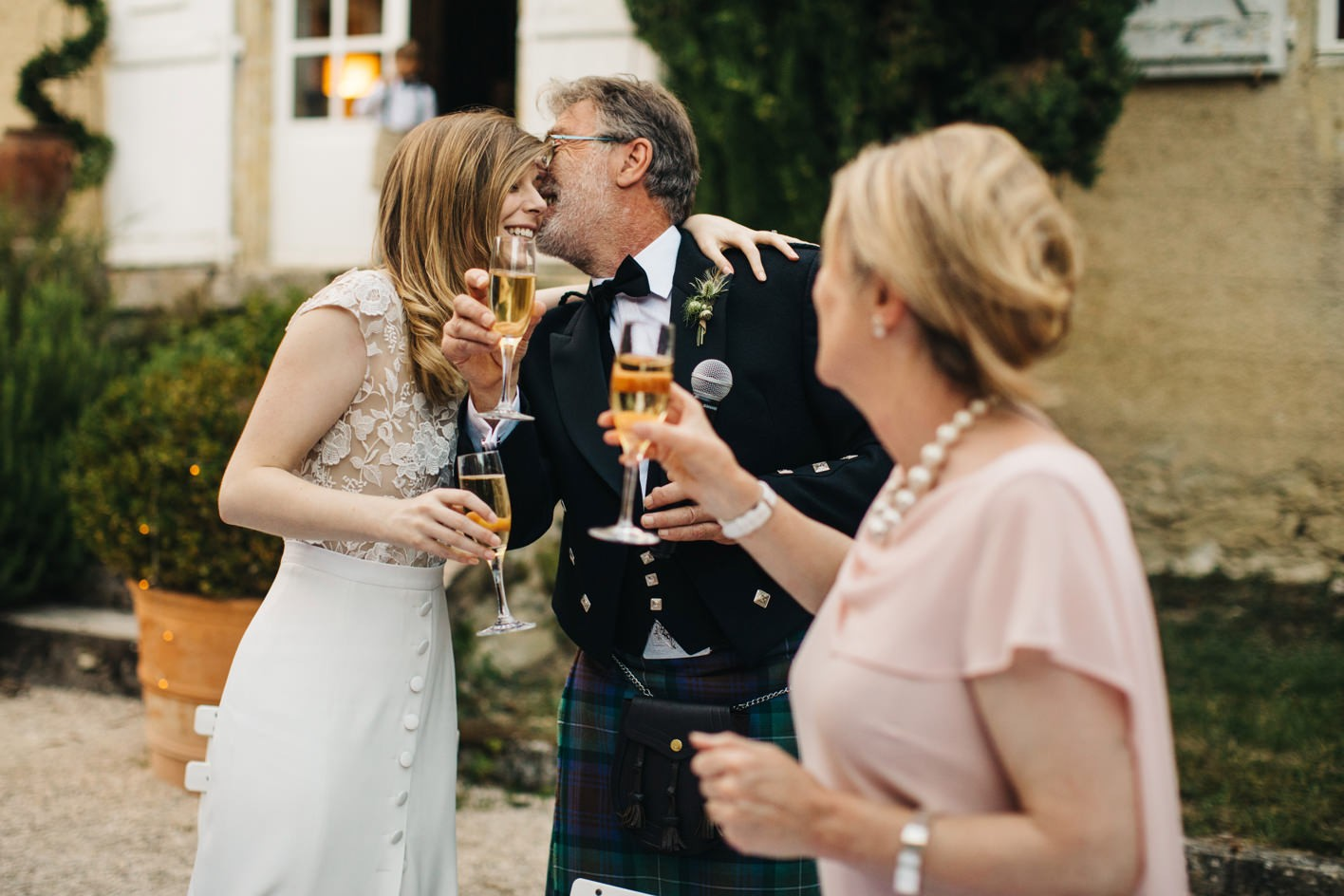 bride kisses father after speech