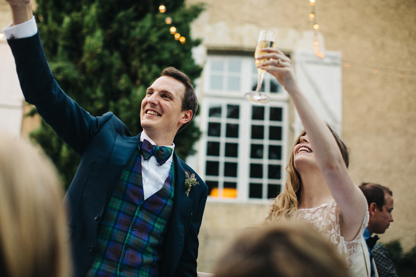 bride and groom raising their glasses