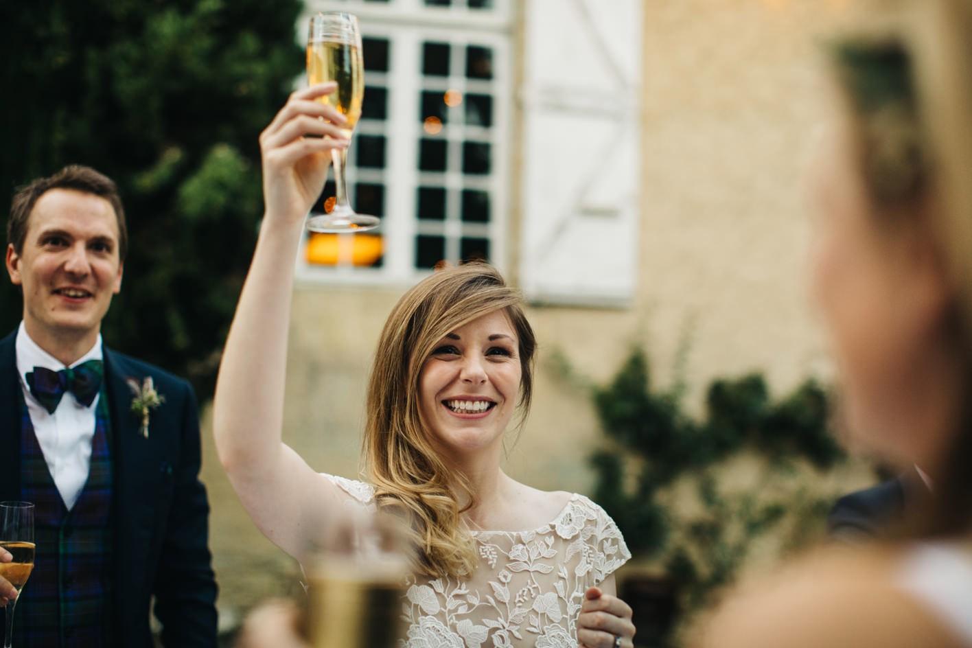 smiling bride during wedding speeches