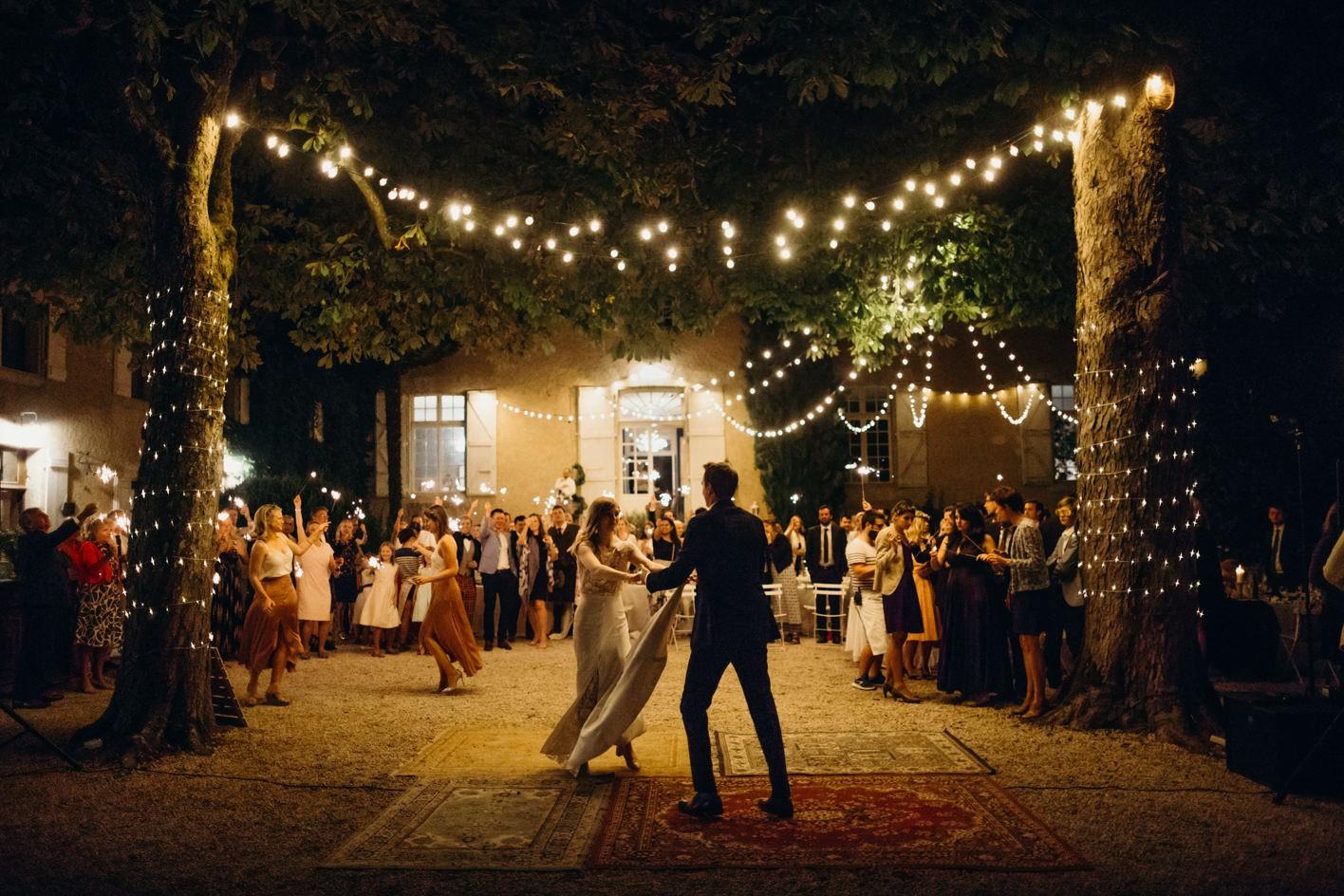 bride and groom dance at chateau de lartigolle