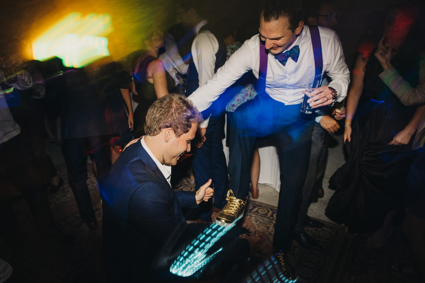 groom wearing lit up trainers