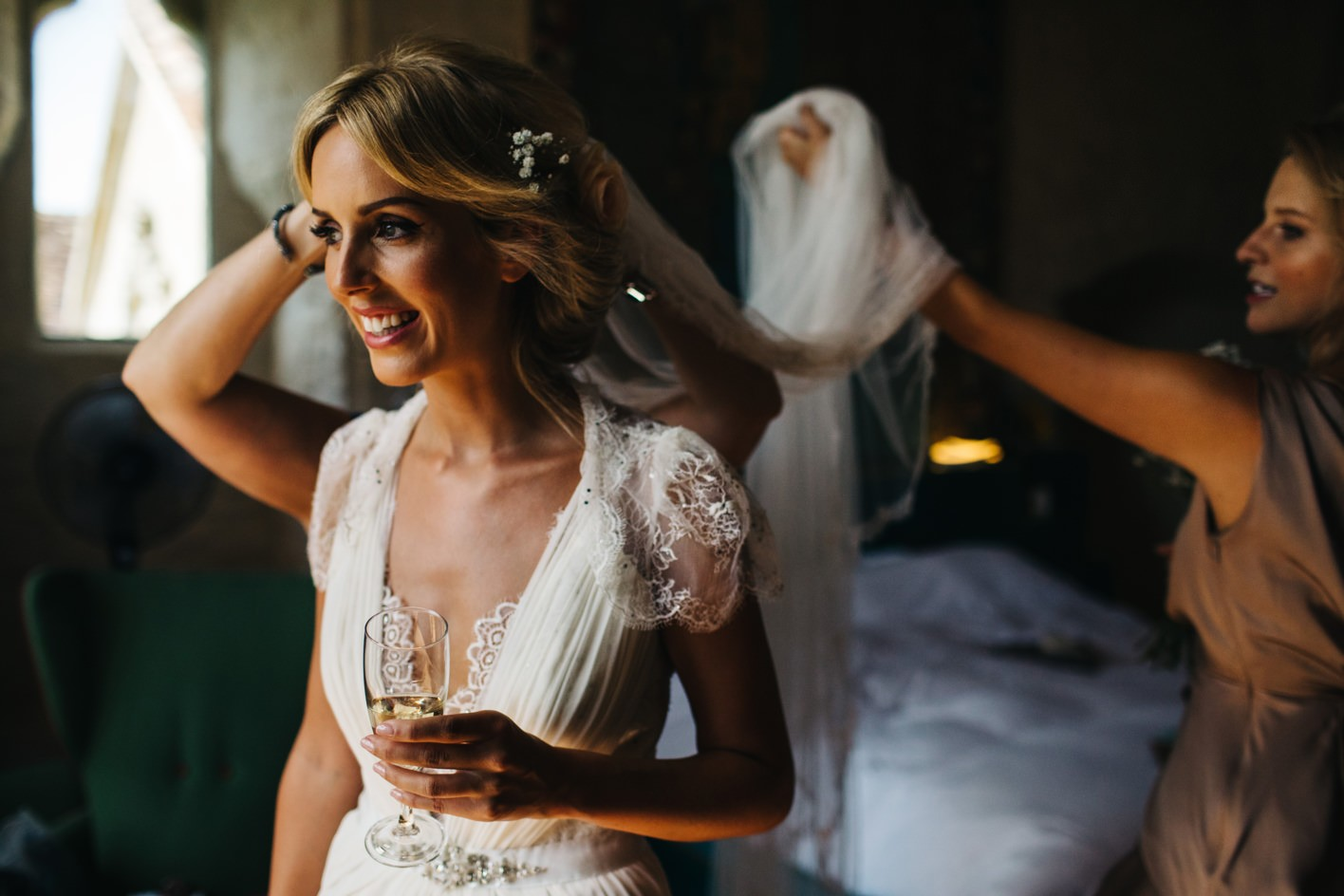 bride having Sassi Holford veil applied