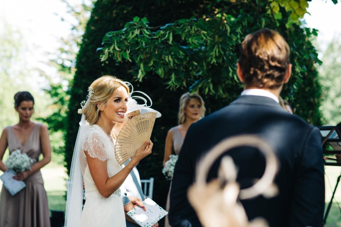 bride glancing at her future husband