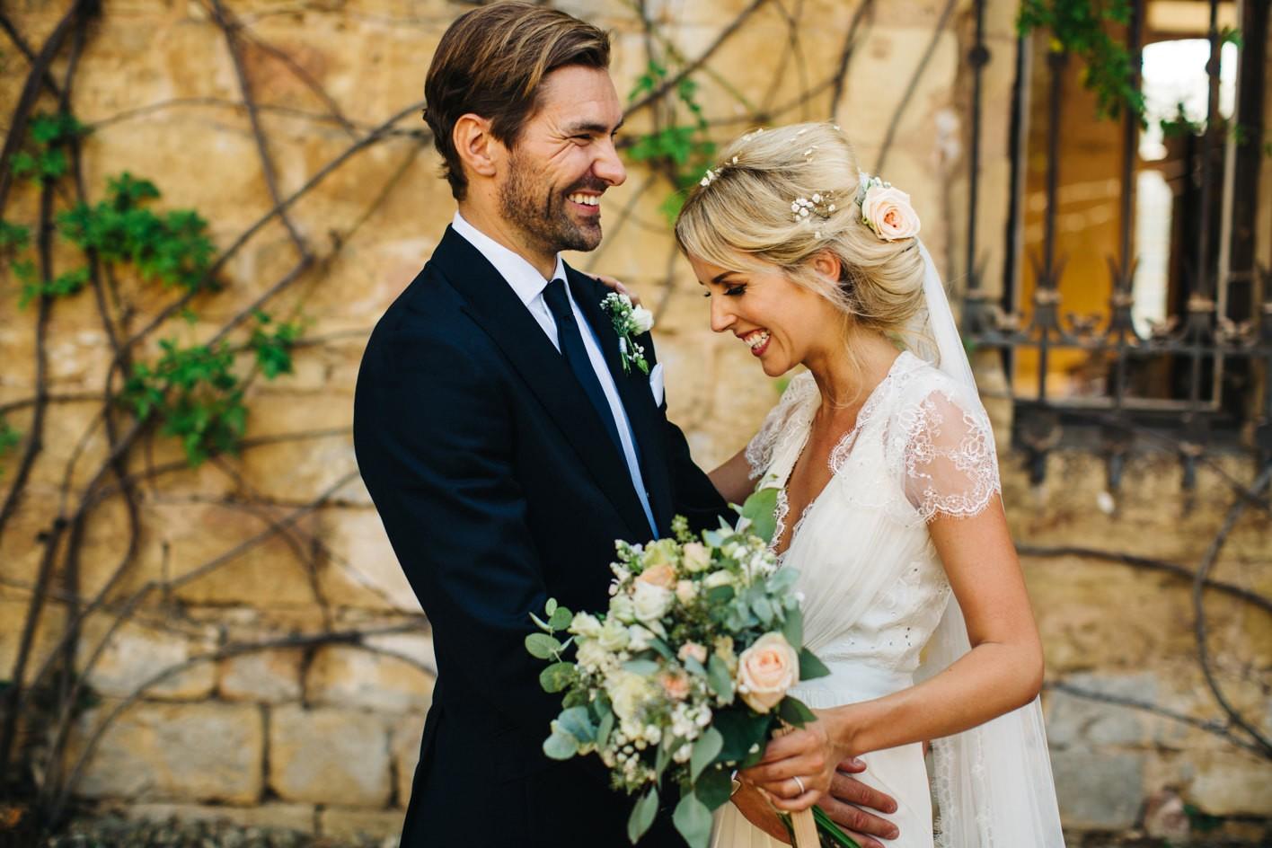 bride with groom wearing jenny packham dress