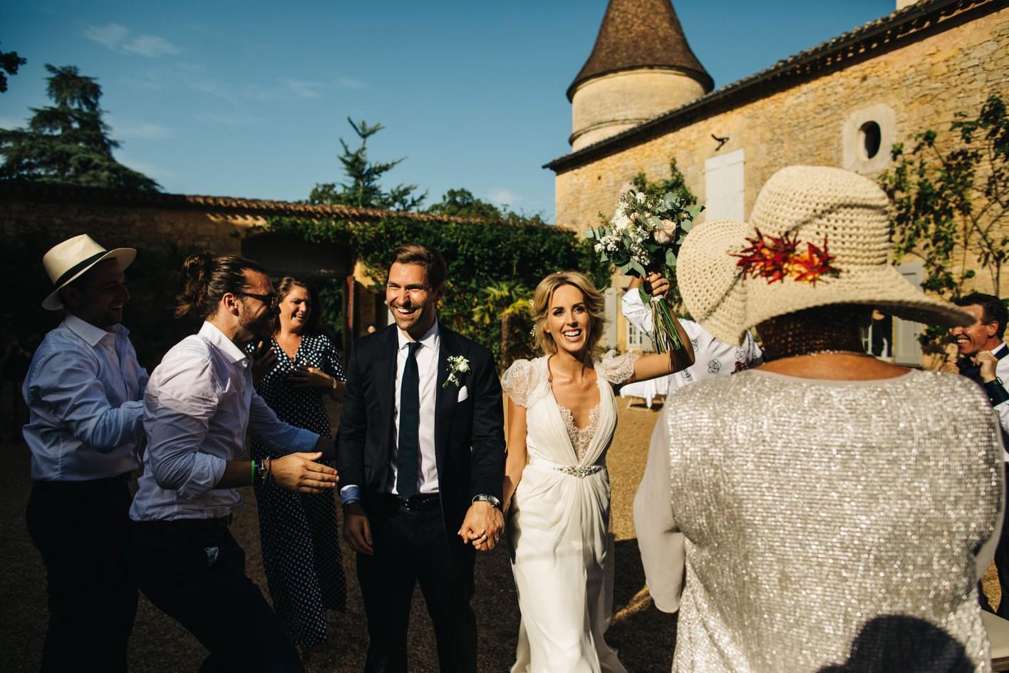 couple making entrance at chateau de la bourlie