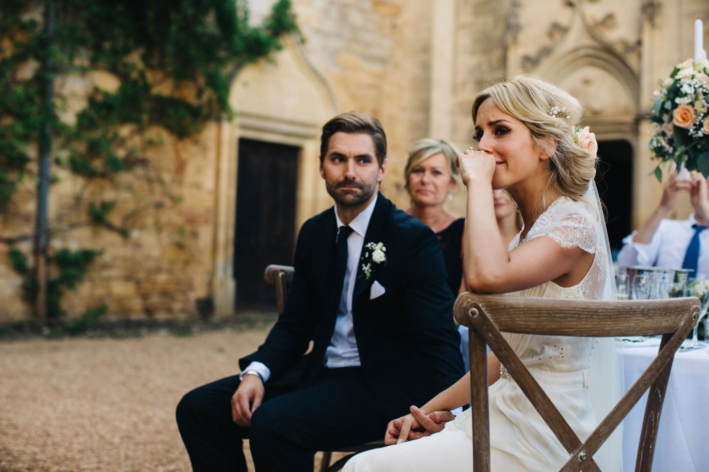 bride cries during speeches