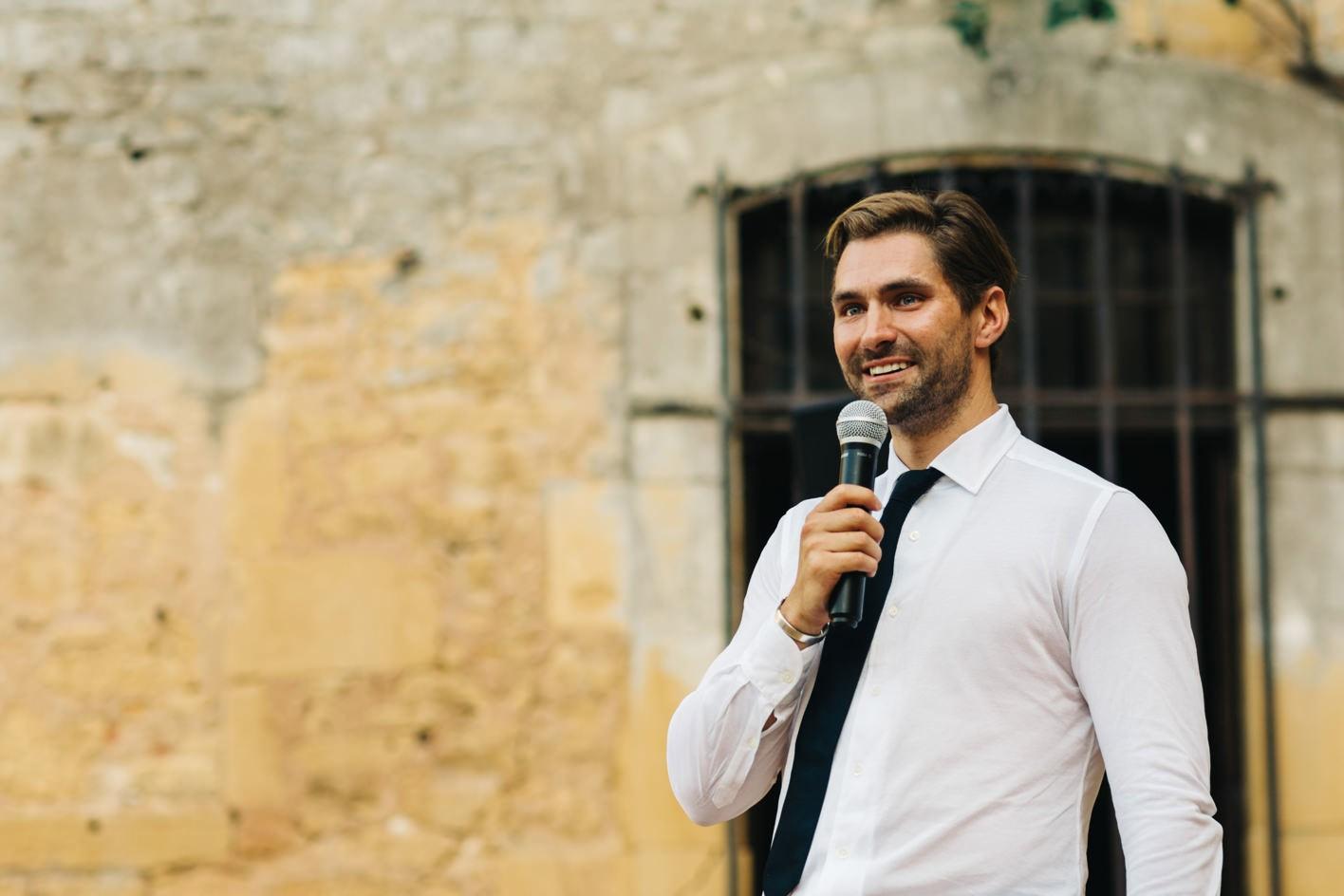 groom with tear in eye during speech