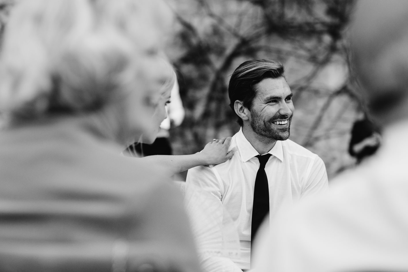 groom gets a hand of support during speech