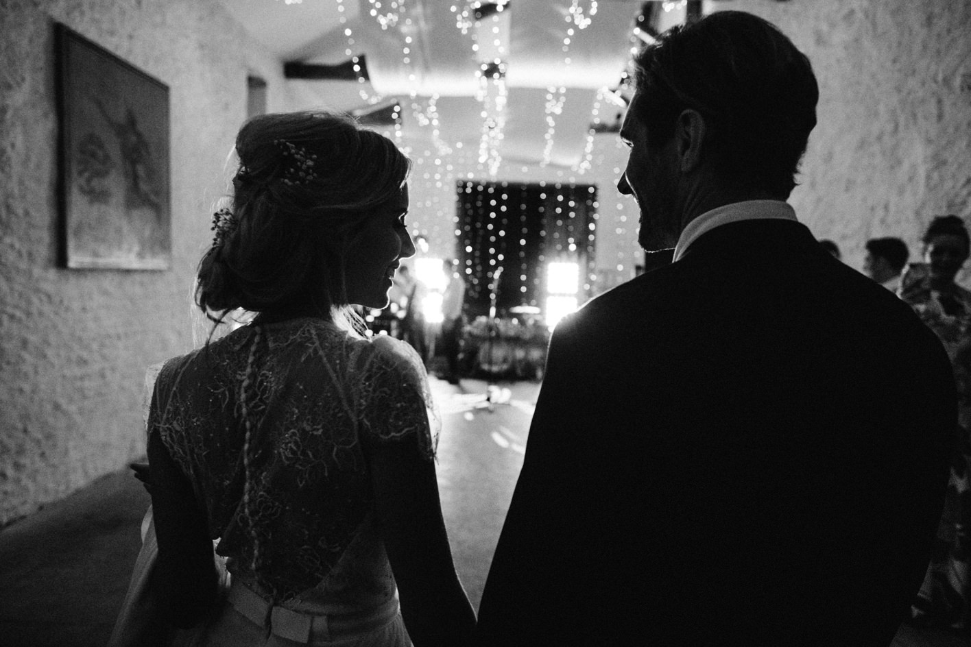 bride and groom making way to dancefloor