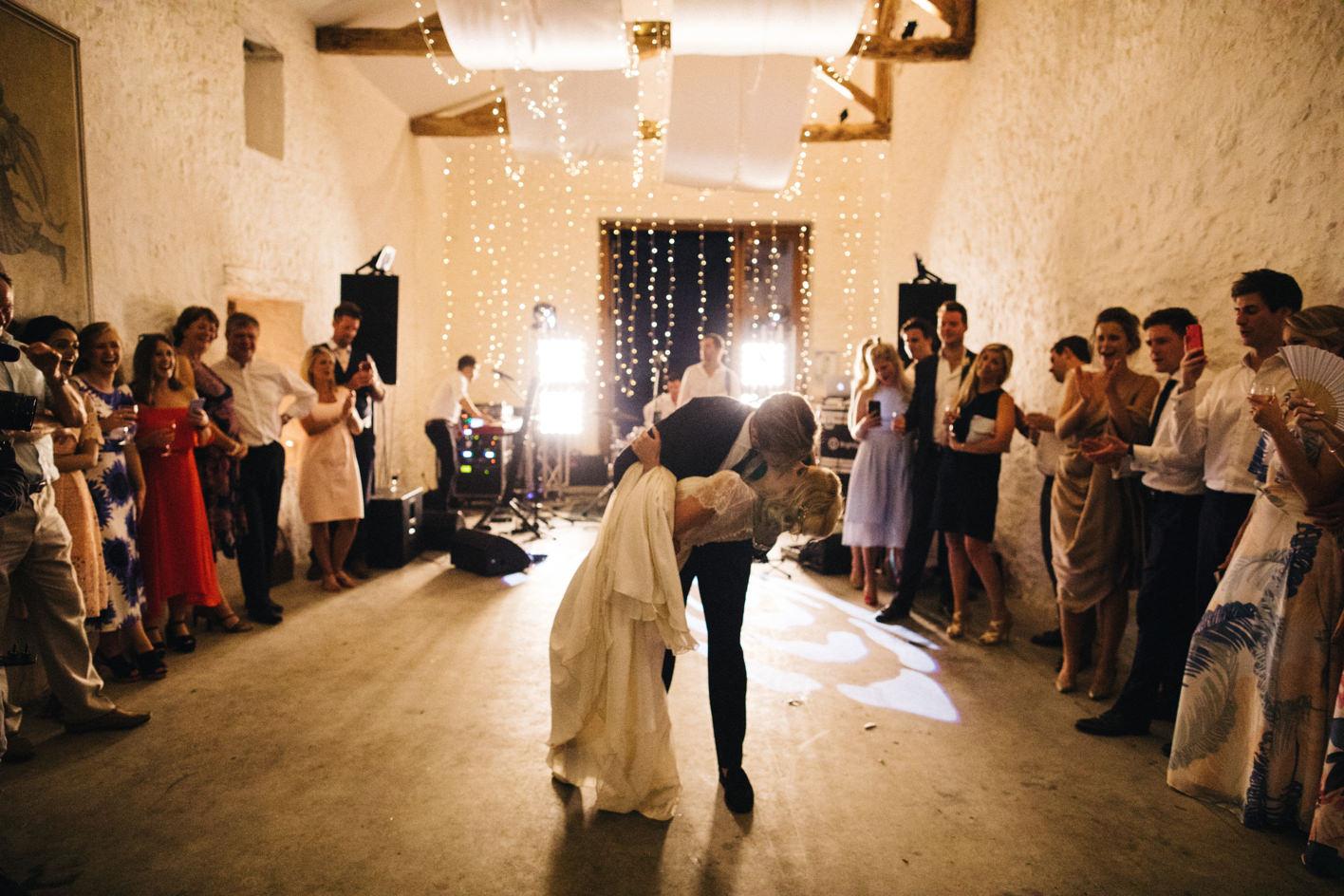 groom bends bride backwards at first dance