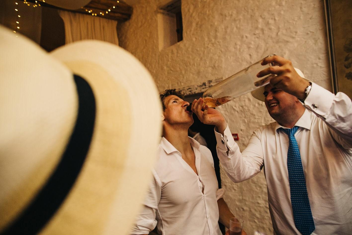 wedding guests drinks bottle of wine