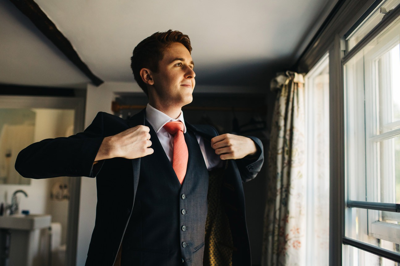 groom wearing a ted baker suit