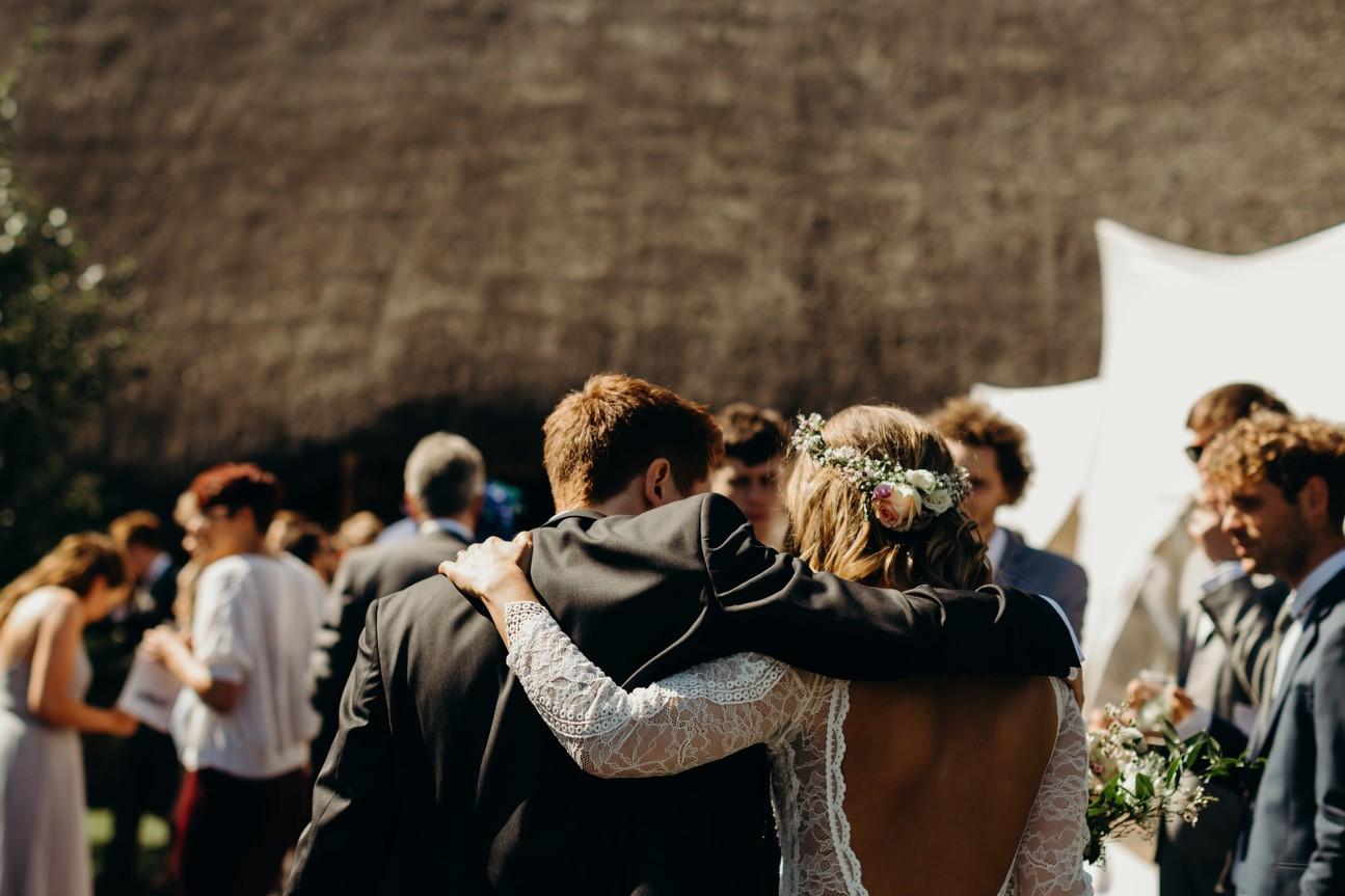 bride and groom walk away together