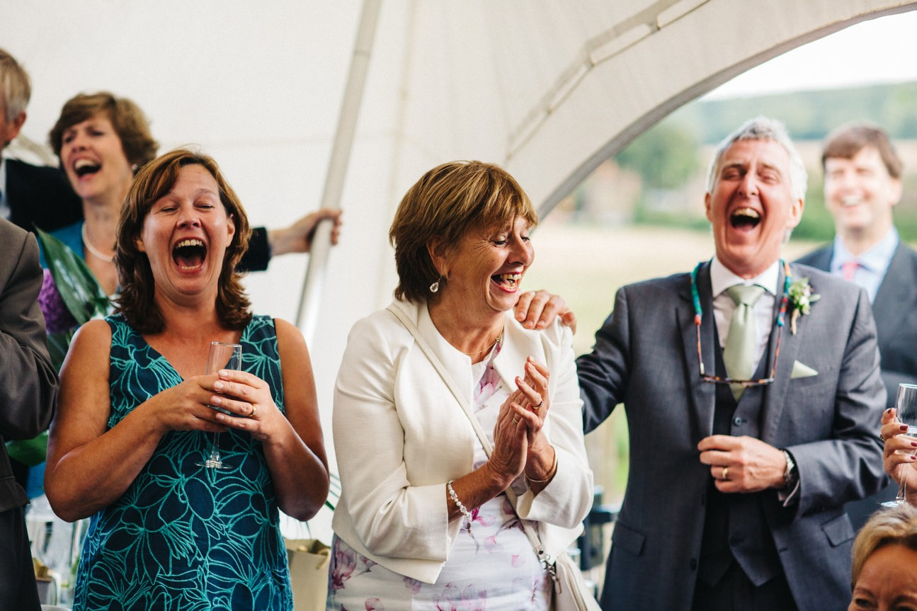 wedding guests lauing