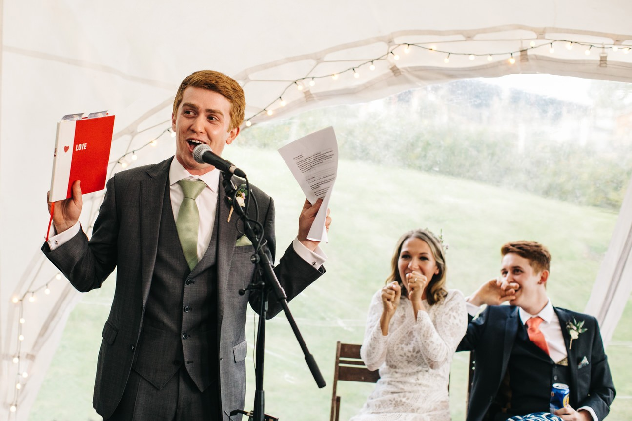 bride and groom surprise during speech