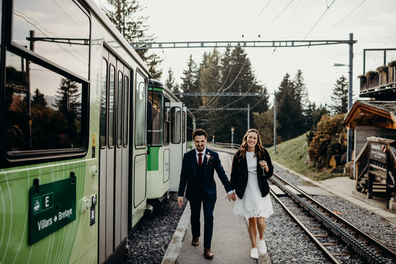 bride and groom change carriages of train