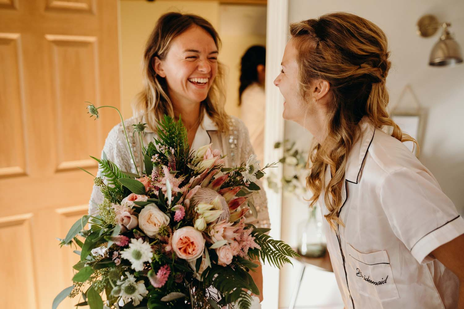 Bride laughing with Wedding bouquet