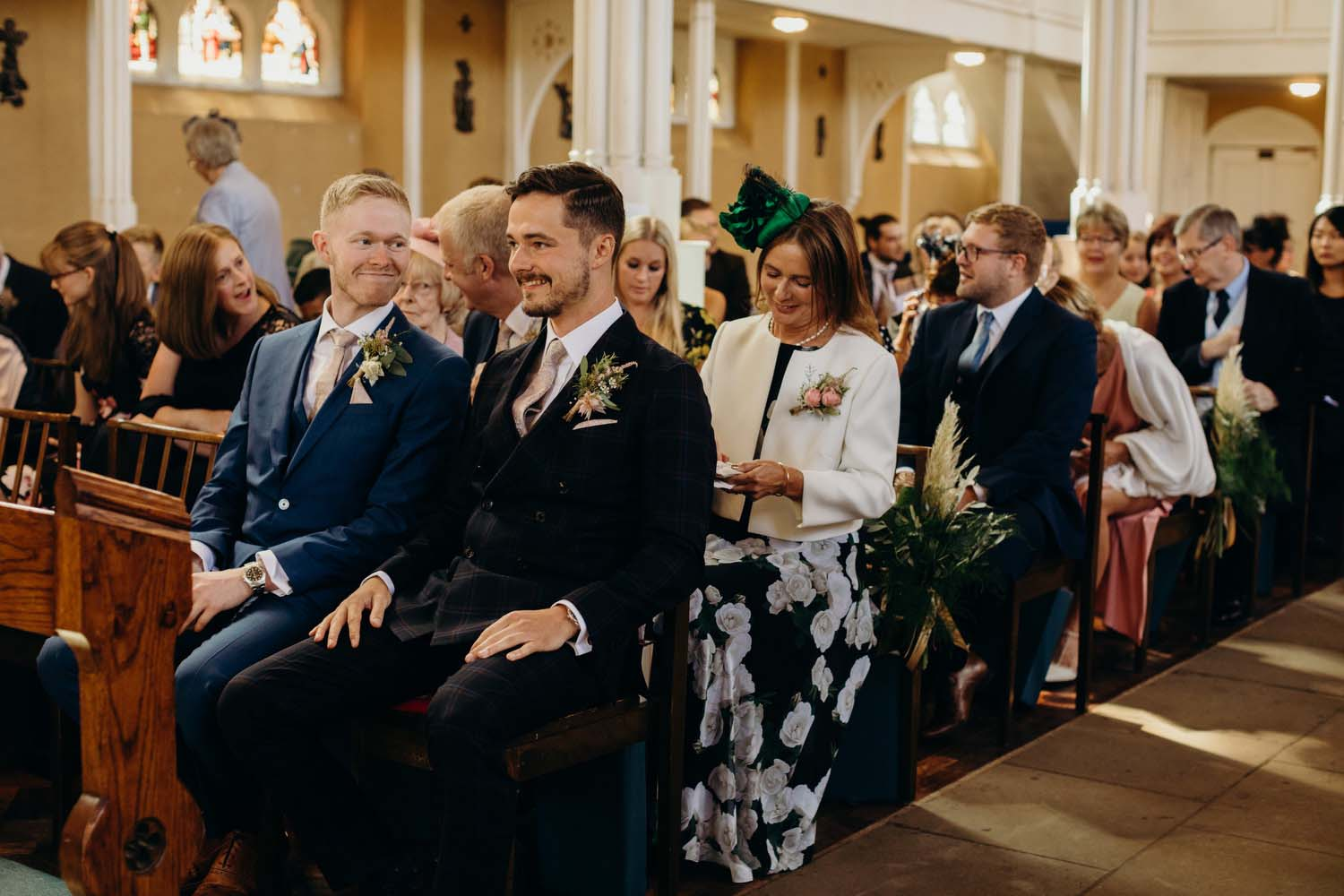 Groom smiling with best man