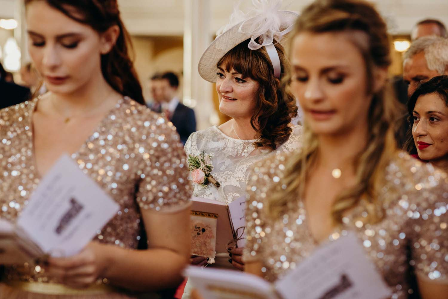 Mother of bride smiling at church wedding