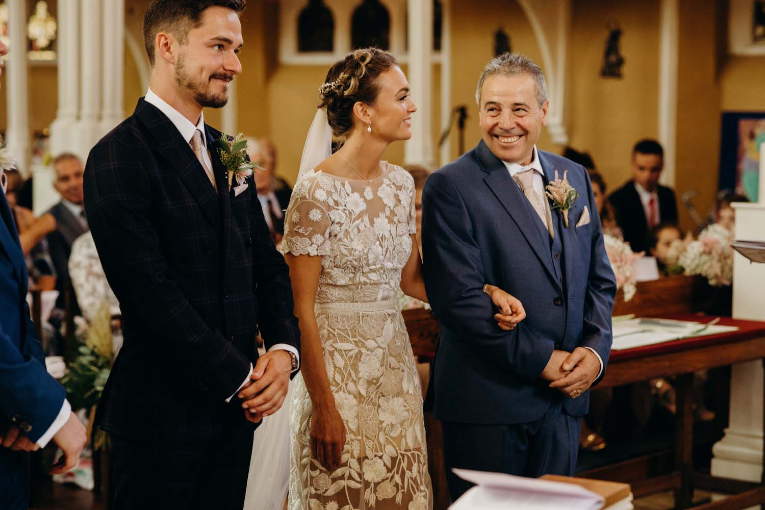 Father of bride smiles at daughter