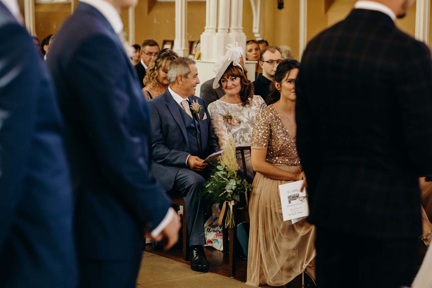 Parents of bride smile at each other
