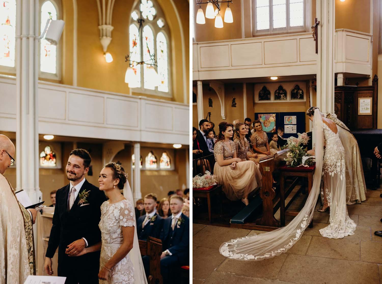 Bride and groom smile at priest