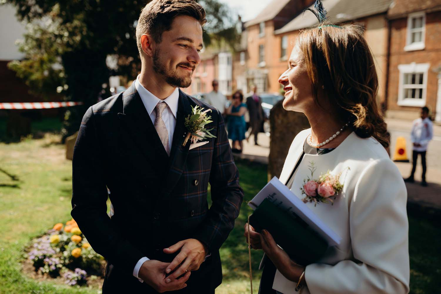 Groom and mother smile at each other